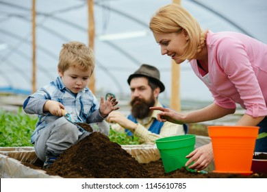 csr with people. csr concept. family in greenhouse do csr activity. people planting together. csr activity with people