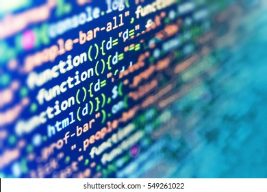 CSS, JavaScript and HTML usage. Binary digits code editing. Developer working on websites codes in office. Abstract IT technology background.  Big data and Internet of things trend.