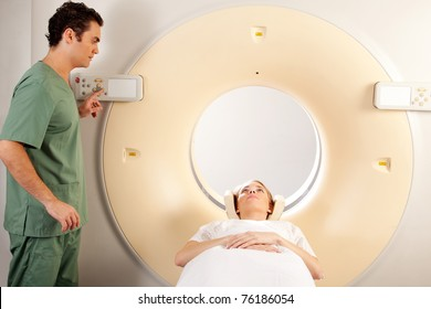A CT Scanner Technician preparing a patient for scanning