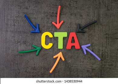 CTA, Call to action in advertising and communication concept, multi color arrows pointing to the word CTA at the center of black cement chalkboard wall.
