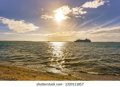 Cuba, Backlit image of a cruise ship in the city bay. Cienfuegos city center is a Unesco World Heritage Site thus cruise ships bring tourists to enjoy the international landmark
