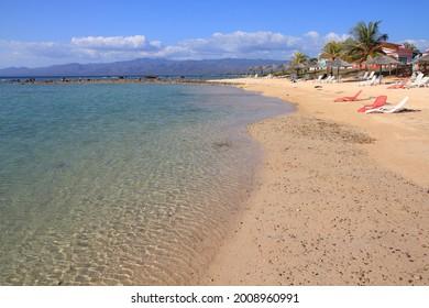Cuba beach landscape - palm trees at Ancon Beach, Trinidad.