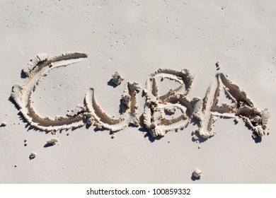 Cuba carved on the white sand of a beach in Cuba