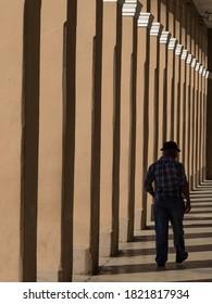 Cuba, Cienfuegos, man walking in colonnade. - Shutterstock ID 1821817934