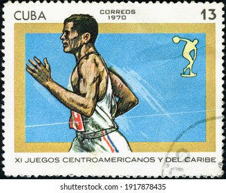 CUBA - CIRCA 1970: A stamp printed in Cuba shows the running athlete
