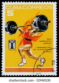CUBA - CIRCA 1973 :A post stamp printed in Cuba shows athlete competing in weight-lifting,series. Circa 1973