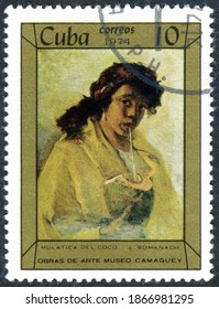 """CUBA - CIRCA 1974: A stamp printed in Cuba, shown the painting """"Mulatto Woman Drinking from Coconut"""", by artist Leopoldo Romanach y Guillen, circa 1974"""