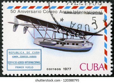 CUBA - CIRCA 1977: A stamp printed in Cuba shows Flying boat and international airmail service 1st flight cachet, series International Airmail Service, 50th Anniversary, circa 1977
