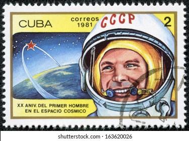 CUBA - CIRCA 1981: cancelled stamp printed in CUBA, shows first russian, soviet astronaut Yury Gagarin, space-vehicle shuttle orbit, circa 1981. 20 anniversary of 1st space flight.