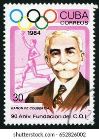 CUBA - CIRCA 1984: post stamp printed in Cuba shows Baron de Coubertin, torchbearer; international Olympic committee; 90th anniversary; Scott 2715 A740 30c, circa 1984