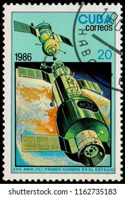 CUBA – CIRCA 1986: A stamp printed in Cuba shows an image of the Vostok 1 spacecraft, as part of a series celebrating the 25th anniversary of the first human in space.