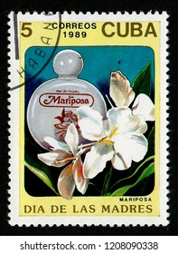 CUBA - CIRCA 1989: A postage stamp printed in Cuba shows a Mariposa perfume bottle and lilies in a series dedicated to Mothers Day.