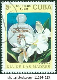 CUBA - CIRCA 1989: A stamp printed in Cuba shows a bottle of mariposa perfume, circa 1989