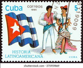 """CUBA - CIRCA 1990: A stamp printed in Cuba from the """"Latin American History 5th series"""" issue shows Flag and Traditional Costumes Cuba, circa 1990."""