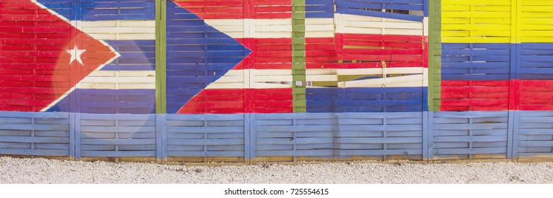 Cuba, Colombia, Porto Rico and Costa Rica painted flags on a wooden wall