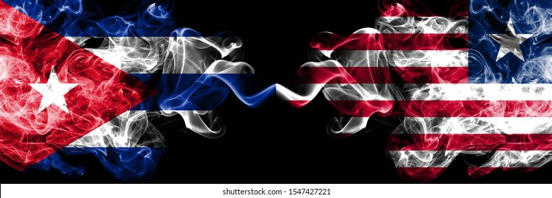 Cuba, Cuban vs Liberia, Liberian smoky mystic flags placed side by side. Thick colored silky travel abstract smokes banners