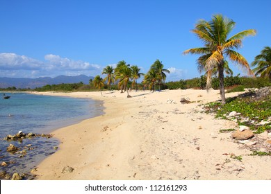 Cuba - famous Playa Ancon beach. Caribbean seaside destination.