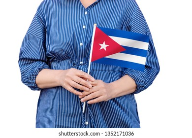 Cuba flag. Close up of woman's hands holding a national flag of Cuba isolated on white background.