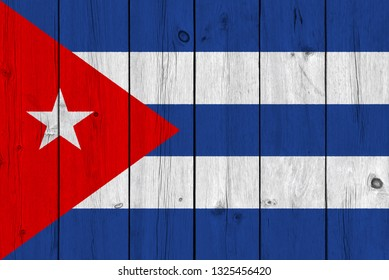 Cuba flag painted on old wood plank. Patriotic background. National flag of Cuba