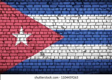 Cuba flag is painted onto an old brick wall