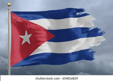 Cuba Flag with torn edges in front of a stormy sky