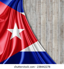 Cuba flag and wood background