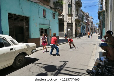 Cuba, Havana - 07 April, 2016: a typical day in Havana, Cuba, in one of the streets with people doing their routine things, with tourist passing by and feeling the spirit of real Cuba