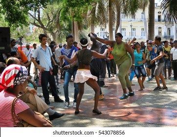 Cuba, Havana - 07 April, 2016: a passionate cuban dance salsa dancing in one of the central squares of Havana, tourists and locals enjoy themselves to the hot rhythms of latin american dances