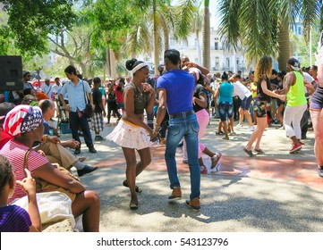 Cuba, Havana - 07 April, 2016: street dances of salsa in one of the central squares in Havana, where both the locals and the tourists can take the dance floor and dance till they drop, a fun event