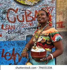 Cuba, Havana - 07 April, 2016: a traditional Cuban woman fortune teller with a cigar - an authentic image and colorful style