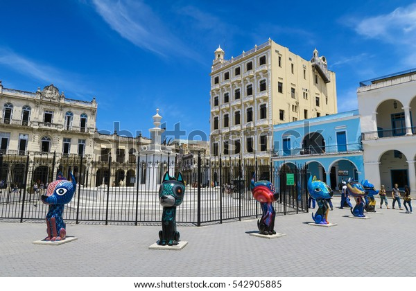 Cuba, Havana - 07 April, 2016: one of the central squares of Havana with modern colorful installations - 10 or 12 cat figures around a fountain, on a bright sunny day, nice entertainment for children