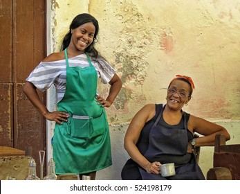 Cuba, Havana - 08 April, 2016: hospitable and friendly women, a waitress and a cook, posing and smiling into the lens of the camera, both beautiful and open