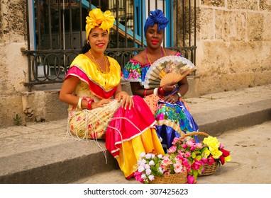 Cuba Havana 2005 Year December 12 . Two cuban woman in traditional cuban dress on the Havana street