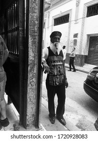 "Cuba - Havana 5/6/19 black and white. old man standing outside the famous bar ""La Bodeguita del medio"" Where the Mojito was invented."