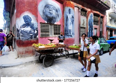CUBA, HAVANA - JUNE 28, 2013: Unidentified schoolgirls in school uniform walking on the street. Education in Cuba is public and free for all citizens and literacy is at 99.8%