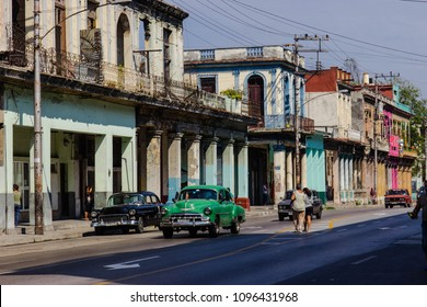 Cuba, Havana, March 2018. Colorful street of Havana with colonial architecture and old cars
