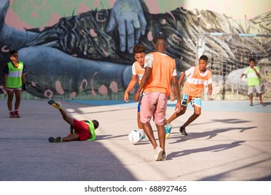CUBA, HAVANA - MAY 5, 2017: Boys are playing football. Copy space for text