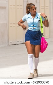 CUBA, HAVANA - MAY 5, 2017: Schoolgirl in the shape on the street. Copy space for text