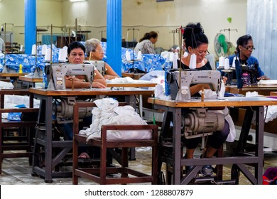 CUBA, HAVANA - NOV 5, 2017: Workers at the garment factory.  Ladies working in a sewing company. Cloth factories in Cuba are poorly equipped, workers need to do their jobs using old sewing machines.