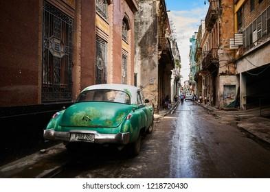 CUBA, HAVANA - NOVEMBER 09,2017: Vintage cars parking on the old street Havana