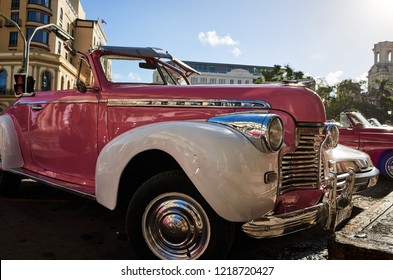 CUBA, HAVANA - NOVEMBER 14,2017: Vintage cars parking on the old street Havana