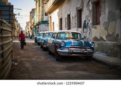 CUBA, HAVANA - NOVEMBER 14,2017: Vintage cars parking on the old street of Havana