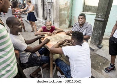 Cuba, Havana: Street scene with a group of Cuban men people who play the famous game domino in the city center of the Cuban capital. March 2015