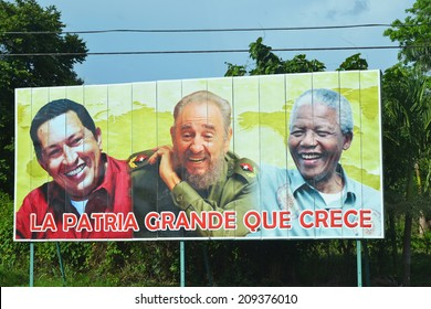 CUBA - JULY 23: billboard depicting political leaders of Venezuela, Cuba and South Africa located in Cuba on July 23, 2014. Propaganda billboards are common throughout Cuba since the Revolution.