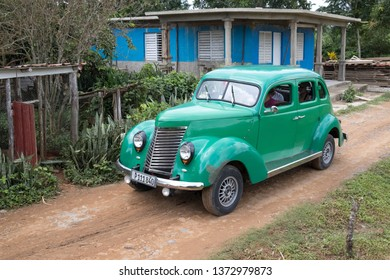 Cuba - July 31, 2017: Vintage car driving in the countryside outside of Havana, Cuba.