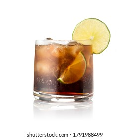 Cuba Libre cocktail with brown rum, lemon juice, coke and ice cubes, decorated with fresh lime slice isolated on white background
