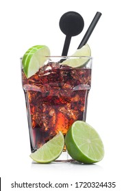 Cuba Libre Cocktail in glass with ice cubes and slices of lime with black straw and stirrer on white background with raw limes