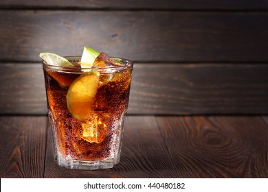 Cuba Libre. Cuba Libre Cocktail in a glass with ice against a dark background