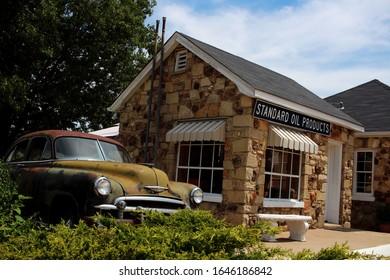Cuba, Missouri - June 12 2015: A vintage car next to a rock building on Route 66.