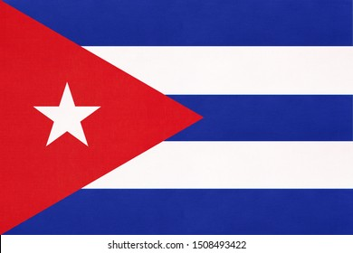 Cuba national fabric flag, textile background. Symbol of international world America caribbean country. State Cuban official sign.